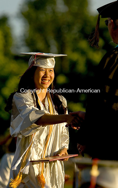 WOLCOTT, CT--20 JUNE 2007--062007JS12-Wolcott High School graduate Sabina Do receives her diploma during Wednesday's commencement ceremonies at Wolcott High School.<br /> Jim Shannon/Republican-American