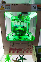 """A MakerBot Industries """"Thing-O-Matic"""" 3d printer is seen in the Wired pop-up store in Times Square in New York on Wednesday, November 23, 2011. The device, which may revolutionize small industry, enables the user to produce small plastic objects manufactured via extrusion on their desktop via this automated machine. (© Richard B. Levine)"""