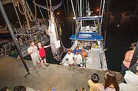 Angler Jen Brooks stands with husband Evan next to a Pacific blue marlin grander near the fishing boat Lana Kila and her crew, Honokohau Harbor, Big Island.