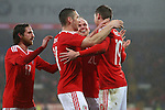 Simon Church of Wales celebrates his goal during the international friendly match at the Cardiff City Stadium. Photo credit should read: Philip Oldham/Sportimage