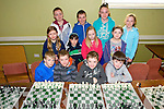Team from Knocknagoshel at the Kerry Community Games Chess Tournament, held in Na Gael GAA Club on Sunday. Pictured front l-r Eoin McSweeney, Jack McElligott, Cathal McElligott, Evan Collins, Middle l-r Erin Cotter, Kelly Ann Nix, Shauna Curtin, Brauna Curtin, Back Darragh Conan, Dermot Shine, Roisin Brosnan and Niamh Brosnan