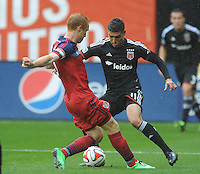 Washington, D.C.- March 29, 2014. Luis Silva (11) of D.C. United goes against Jeff Larentowicz of the Chicago Fire. The Chicago Fire tied D.C. United 2-2 during a Major League Soccer Match for the 2014 season at RFK Stadium.