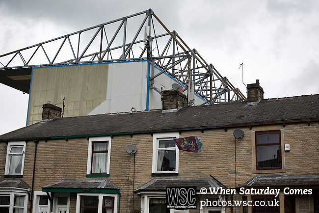 Burnley 1 West Ham United 3, 18/10/2014. Turf Moor, Premier League. A terraced house with a football flag in front of the Jimmy McIlroy stand at The fixture was won by the visitors by three goals to one watched by 18,936 spectators. The defeat meant that Burnley still had not won a league match since being promoted from the Championship the previous season. Photo by Colin McPherson.