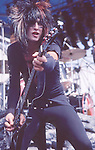 Nikki Sixx of Motley Crue  at Castle Donnington , England Aug 1984 Donnington Monsters of Rock 1984 Donnington 1984