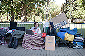 October 21, 2011. Raleigh, NC.. Dani Moore (left) and Pearl Clutcher sit on the sidewalk outside the perimeter of the Capitol building.. Many supporters of the Occupy Wall Street protestors have been camping out on the sidewalk outside the State Capitol building to show solidarity with those around the globe.
