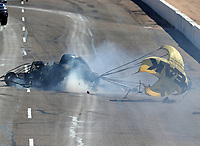 Feb 25, 2018; Chandler, AZ, USA; NHRA funny car driver John Force crashes during the Arizona Nationals at Wild Horse Pass Motorsports Park. Mandatory Credit: Mark J. Rebilas-USA TODAY Sports