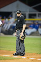 Home plate umpire Grant Hinson between innings of the Appalachian League game between the Bluefield Blue Jays and the Burlington Royals at Burlington Athletic Stadium on June 27, 2016 in Burlington, North Carolina.  The Royals defeated the Blue Jays 9-4.  (Brian Westerholt/Four Seam Images)