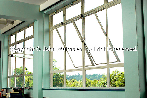 Metal framed windows in school classroom.