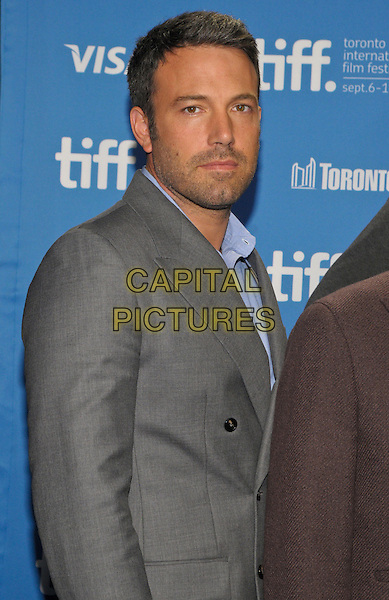 "Ben Affleck.""Argo"" Photocall - 2012 Toronto International Film Festival held at Ryerson Theatre, Toronto, Ontario, Canada..September 6th, 2012.TIFF half length suit side grey gray blue shirt collar stubble facial hair .CAP/ADM/BPC.©Brent Perniac/AdMedia/Capital Pictures."