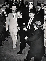 BNPS.co.uk (01202 558833)<br /> Pic: HeritageAuctions/BNPS<br /> <br /> Oswald's was gunned down by Jack Ruby two days after assasinating JFK.<br /> <br /> The last paycheck issued to President Kennedy's killer Lee Harvey Oswald has emerged for sale for £15,000. ($20,000)<br /> <br /> Also going under the hammer is Oswald's 1957 high school yearbook for his final year at Arlington Heights High School in Fort Worth, Texas.<br /> <br /> One bizarre photo inside the yearbook, which is expected to fetch £1,200, shows him being hypnotised by a female pupil.<br /> <br /> Oswald infamously shot John F Kennedy while his motorcade passed through Dallas, Texas on November 22, 1963.<br /> <br /> The former marine was himself assassinated by Jack Ruby at the local police headquarters two days later.