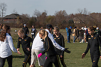 Missouri coach Marc Burns encourages his women before their victory in the 6k race at the 2016 NCAA Division I Cross Country Midwest Regional in Iowa City, Ia. Friday, November 11.