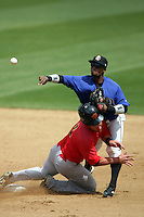 April 28, 2010: Ivan Contreras of the Rancho Cucamonga Quakes throws to first base while being slid into by Josh Ford of the Visalia Rawhide at The Epicenter in Rancho Cucamonga,CA.  Photo by Larry Goren/Four Seam Images