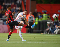 Sheffield United's Enda Stevens (right) crosses the ball despite the attentions of  Bournemouth's Joshua King (left) <br /> <br /> Photographer David Horton/CameraSport<br /> <br /> The Premier League - Bournemouth v Sheffield United - Saturday 10th August 2019 - Vitality Stadium - Bournemouth<br /> <br /> World Copyright © 2019 CameraSport. All rights reserved. 43 Linden Ave. Countesthorpe. Leicester. England. LE8 5PG - Tel: +44 (0) 116 277 4147 - admin@camerasport.com - www.camerasport.com