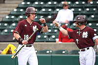 Brent Rooker (19) of the Mississippi State Bulldogs is greeted by teammate Hunter Stovall (2) after scoring during a game against the Southern California Trojans at Dedeaux Field on March 5, 2016 in Los Angeles, California. Mississippi State defeated Southern California , 8-7. (Larry Goren/Four Seam Images)