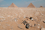 CAIRO - NOVEMBER 30, 2004 : Trash litter the landscape at the 5000 years old Giza pyramids in Cairo, on November 30, 2004. Sitauated high on a desert plateau overlooking sprawling Cairo, Giza is the most visited tourist site in Egypt ,with the Sphinx and the 481ft high great Pyramid. Tourism has been on the decline in Egypt following a series of terrorist attacks targeting foreign tourists. (Photo by Jean-Marc Giboux)