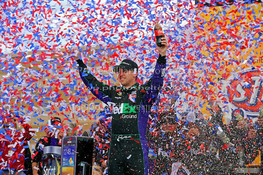 Winner Denny Hamlin, (#11) FedEx Ground Camry, in Victory Lane.