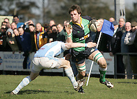 Ballynahinch second row Chris Napier on the attack get ready to fend off Lorcan Bourke during the AIB Cup semi-final against Garryowen at Ballymacarn Park, Ballynahinch. Mandatory Credit - John Dickson