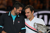 January 28, 2018: Number two seed Roger Federer of Switzerland and number six seed Marin Cilic of Croatia share a moment during the presentation of trophies after Federer won the Men's Final against on day fourteen of the 2018 Australian Open Grand Slam tennis tournament in Melbourne, Australia. Federer won 3 sets to 2. Photo Sydney Low