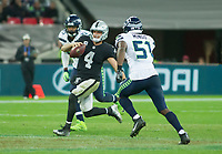 Oakland Raiders Quarterback Derek Carr (4) runs with the ball