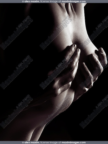 Sensual erotic closeup of man hands on nude woman breast, black and white body parts abstract fine art closeup
