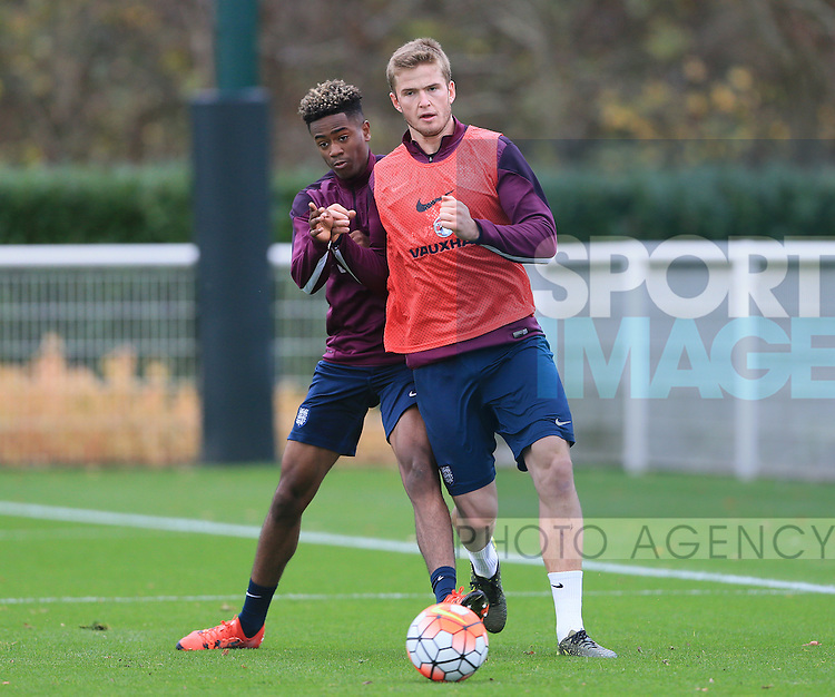 England's Shayon Harrison tussles with Eric Dier during training<br /> <br /> England Training - Tottenham Hotspur Training Ground - England - 16th November 2015 - Picture David Klein/Sportimage