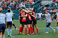 Rochester, NY - May 21, 2016: Western New York Flash midfielders Samantha Mewis (5) and Abigail Dahlkemper (13) along with forward Jessica McDonald (14) celebrate a goal to take a 4-0 lead into half time during a National Women's Soccer League (NWSL) match at Sahlen's Stadium. The Western New York Flash go on to win 5-2.