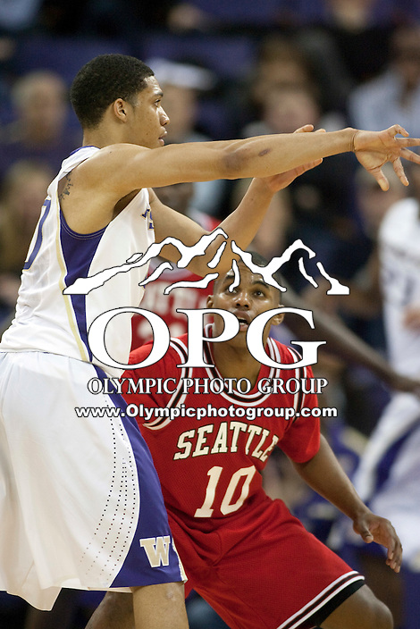 Jan 10, 2012:  Washington Abdul Gaddy passes the ball while being defended by Seattle University's #10 Sterling Carter.  Washington defeated Seattle University  91-83 at Alaska Airlines Arena Seattle, Washington..