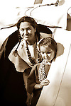 Native American Indian girl and mom in the tipi doorway