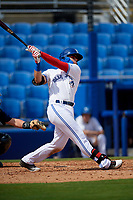 Dunedin Blue Jays first baseman Kacy Clemens (24) follows through on a swing during a game against the Lakeland Flying Tigers on May 27, 2018 at Dunedin Stadium in Dunedin, Florida.  Lakeland defeated Dunedin 2-1.  (Mike Janes/Four Seam Images)