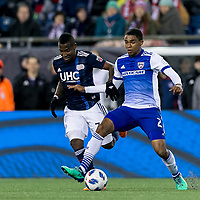 Foxborough, Massachusetts - April 14, 2018: First half action. In a Major League Soccer (MLS) match, New England Revolution (blue/white) vs FC Dallas (white/blue), at Gillette Stadium.
