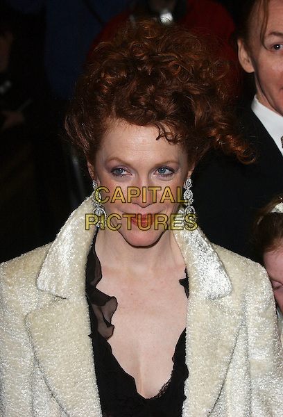 """MADELEINE POTTER.""""The White Countess"""" UK film premiere at Curzon Mayfair, London, UK..March 19th, 2006.Ref: BEL.headshot portrait dangling diamond earrings.www.capitalpictures.com.sales@capitalpictures.com.© Capital Pictures."""
