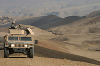 061027-A-5420C-041<br /> <br /> Army Pfc. Raymond Purtee watches the barren hills around him as he provides security from the gun turret of a Humvee during a patrol halt in Bagram, Afghanistan, on Oct. 27, 2006.  Purtee is with the 561st Military Police Company attached to the 10th Mountain Division.  DoD photo by Sgt. 1st Class Dexter D. Clouden, U.S. Army. (Released)