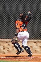 GCL Astros catcher Randy Vasquez (61) looks for a popup during the first game of a doubleheader against the GCL Mets on August 5, 2016 at Osceola County Stadium Complex in Kissimmee, Florida.  GCL Astros defeated the GCL Mets 4-1 in the continuation of a game started on July 21st and postponed due to inclement weather.  (Mike Janes/Four Seam Images)