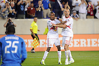 Joel Lindpere (20) of the New York Red Bulls celebrates scoring with Dane Richards (19). The New York Red Bulls and the Chicago Fire played to a 2-2 tie during a Major League Soccer (MLS) match at Red Bull Arena in Harrison, NJ, on August 13, 2011.