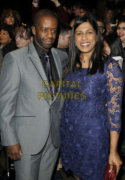 Adrian Lester & Lolita Chakrabarti.The Whatsonstage.com Theatregoers Choice Awards 2013 at the Palace Theatre, Shaftesbury Avenue, London, England..17th February 2013.half length black shirt grey gray suit blue lace dress married husband wife  .CAP/CAN.©Can Nguyen/Capital Pictures.