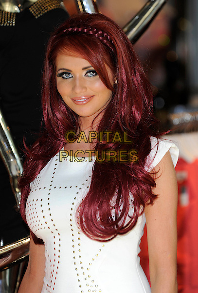 Amy Childs.Launches her new collection of clothes at Lipsy, Bluewater Shopping Centre. Kent, England, UK, May 25th 2012..portrait headshot hair make-up beauty plait braid hairband  band  white studded studs .CAP/DH.©David Hitchens/Capital Pictures.