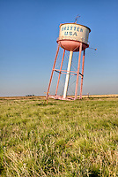 Britten USA leaning water tower in Groom Texas on Route 66.  The water tower was built to be leaning as a way get tourists to stop at the Tower Station and restuarant nest to it.  The station and restuarant are long gone with only the sign and the leaning water tower remaining.
