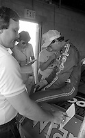 Dale Earnhardt with media garage Pepsi Firecracker 400 Daytona International Speedway Daytona Beach FL July 1987 (Photo by Brian Cleary/www.bcpix.com)