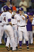 LSU Tigers shortstop Alex Bregman #30 and outfielder Mark Laird #9 wait for teammate Raph Rhymes #4 to come home after his first inning home run against the Auburn Tigers in the NCAA baseball game on March 22nd, 2013 at Alex Box Stadium in Baton Rouge, Louisiana. LSU defeated Auburn 9-4. (Andrew Woolley/Four Seam Images).
