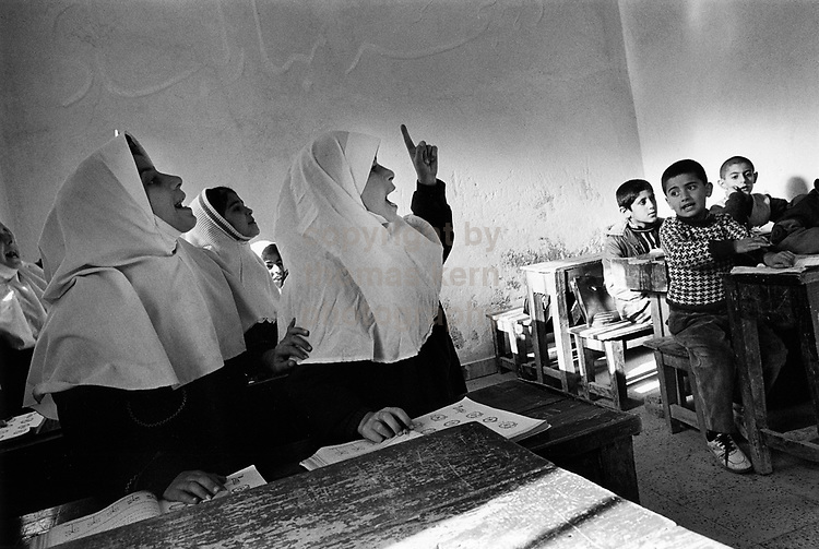 Classroom of the primary school in the village of Masoleh, a beautiful, well known place in the Alborz mountain range. Masoleh, is a tiny place, but well known all over Iran and a populat destination for excursion.  The image one a 1st Prize in the World Press Awards in the daily life, single images section. ©1995 Thomas Kern, www.thomaskern.ch