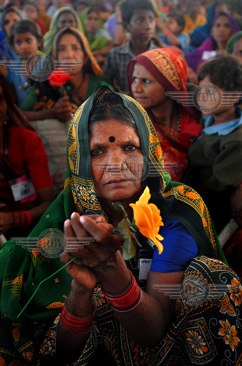 A Dalit woman with a flower attends the 2006 Vanangana conference in Chitrakoot. Vanangana, a women's group dedicated to human rights issues, receives strong support from the Dalit community. The members of the segregated low-ranking Dalit caste perform the most menial jobs in Hindu society and are considered to be literally 'untouchable'..