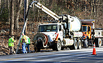 WOODBURY CT. 10 December 2018-121018SV01-DOT crews repair a drainpipe on Sherman Hill Road, Route 64, near Heritage Road in Woodbury Monday. This area is notorious in town for water flowing over it and freezing, often causing spinouts.<br /> Steven Valenti Republican-American
