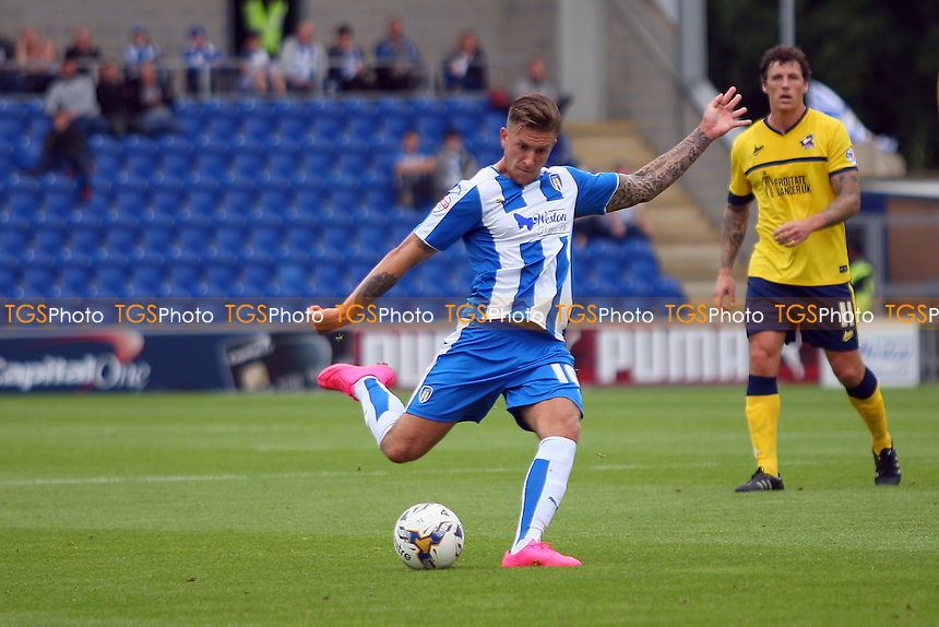 George Moncur of Colchester United takes a shot at goal during Colchester United vs Scunthorpe United, Sky Bet League 1 Football at the Weston Homes Community Stadium, Colchester, England on 29/08/2015