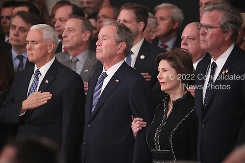U.S. Vice President Mike Pence, former President George W. Bush, former first lady Laura Bush and former Florida Governor Jeb Bush watch as the casket of former President George H.W. Bush arrives to lie in state in the U.S. Capitol Rotunda in Washington, U.S., December 3, 2018. REUTERS/Jonathan Ernst/Pool
