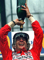 The late Ayrton Senna pours a bottle of champagne over his head after winning the rain shortened Australian Grand Prix in Adelaide, 1993.