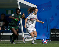 GRENOBLE, FRANCE - JUNE 22: Sara Daebritz #13 of the German National Team brings the ball forward as Chinwendu Ihezuo #19 of the Nigerian National Team pressures during a game between Panama and Guyana at Stade des Alpes on June 22, 2019 in Grenoble, France.