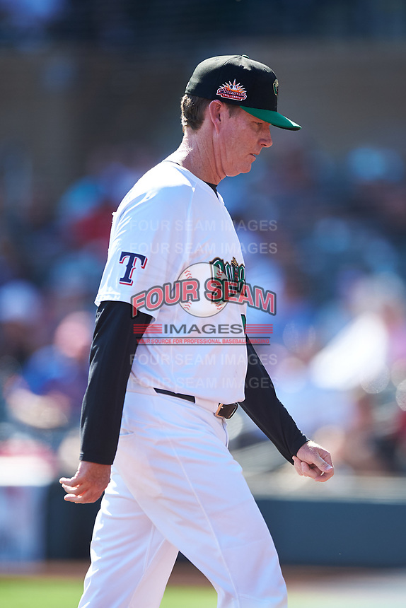 Surprise Saguaros pitching coach Mike Anderson (28), of the Texas Rangers organization, walks off the field after a visit to the mound during the Arizona Fall League Championship Game against the Salt River Rafters on October 26, 2019 at Salt River Fields at Talking Stick in Scottsdale, Arizona. The Rafters defeated the Saguaros 5-1. (Zachary Lucy/Four Seam Images)