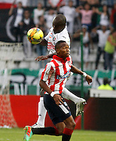 MANIZALES - COLOMBIA -12-04-2014: Fausto Obeso (Izq.) jugador de Once Caldas, disputa el balón con William Tesillo (Der.) jugador de Atletico Junior durante  partido Once Caldas y Atletico Junior por la fecha 17 de la Liga de Postobon I 2014 en el estadio Palogrande en la ciudad de Manizales. /  Fausto Obeso (L) of Once Caldas, figths the ball with William Tesillo (R) of Atletico Junior during a match Once Caldas and Atletico Junior for date 17th of the Liga de Postobon I 2014 at the Palogrande stadium in Manizales city. Photo: VizzorImage  / Santiago Osorio / Str.