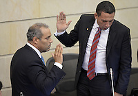 BOGOTA -COLOMBIA. 20-07-2014. José David Name (Izq) jura para posesionarse como presidente del Senado durante la primera plenaria del Senado después de la instalación del Congreso de la República de Colombia por parte del presidente, Juan Manuel Santos en el Salón Elíptico del Capitolio Nacional./ Jose David Name (L) swears to take possession as president of the Senate during the first Senate plenary after the installation of the Congress of the Republic of Colombia by the president, Juan Manuel Santosat Salon Eliptico in the National Capitol. Photo: VizzorImage/ Gabriel Aponte / Staff