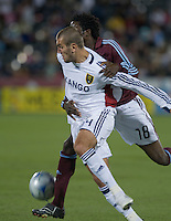 Real Salt Lake forward Yura Movsisyan holds off Colorado defender Ugo Ihemelu (red). Real Salt Lake earned a tied versus the Colorado Rapids securing a place in the postseason. Dick's Sporting Goods Park, Denver, Colorado, October, 25, 2008. Photo by Trent Davol/isiphotos.com
